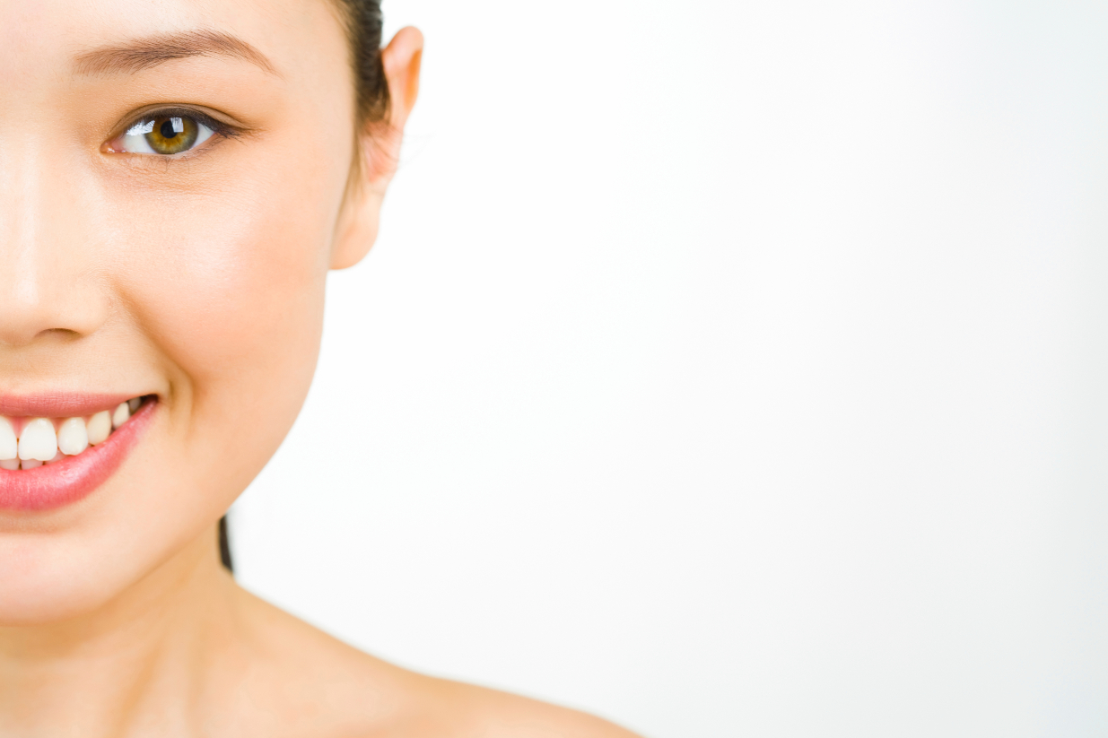 Single Smiling Woman with Beautiful Skin